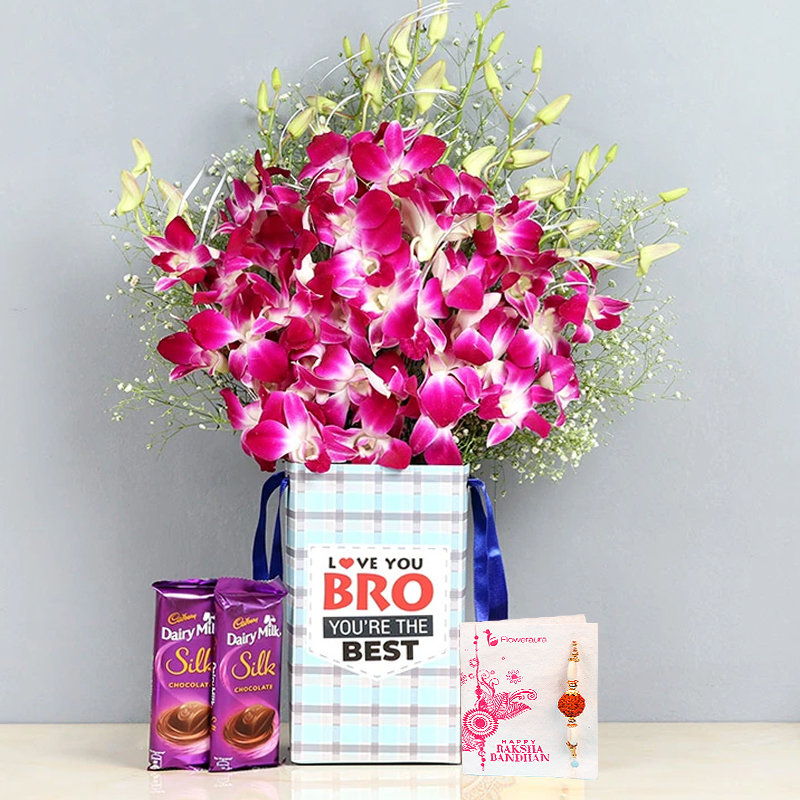 Silky Orchids Rakhi Combo - 6 Purple Orchids in Floral Box for Brother One Designer Rakhi 2 Dairy Milk Silk