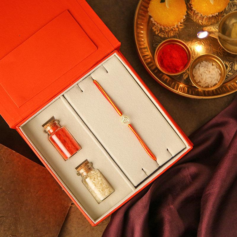 Gold Designer Rakhi Online - 18k Gold Waheguru Rakhi Pack