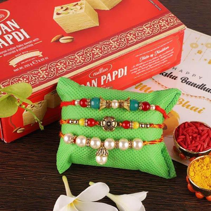 3 Designer Rakhis And Soan Papdi Combo