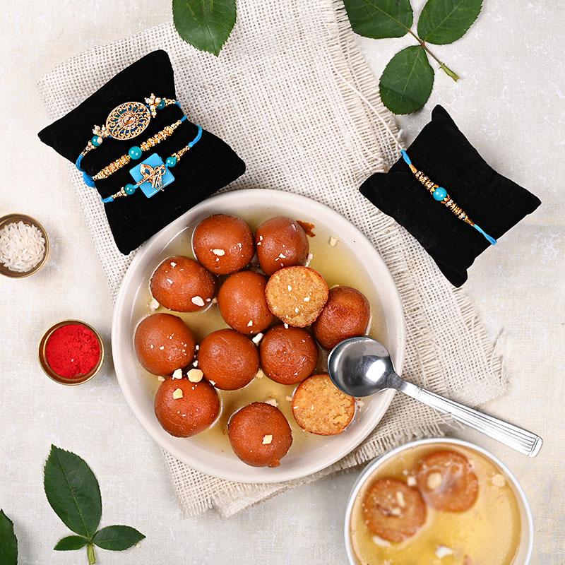 3 Pretty Blue Rakhi Set with Gulab Jamun