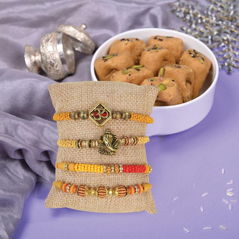 Set of 4 Divine Rakhis - 2 Rakhi Set With Sweets Combo