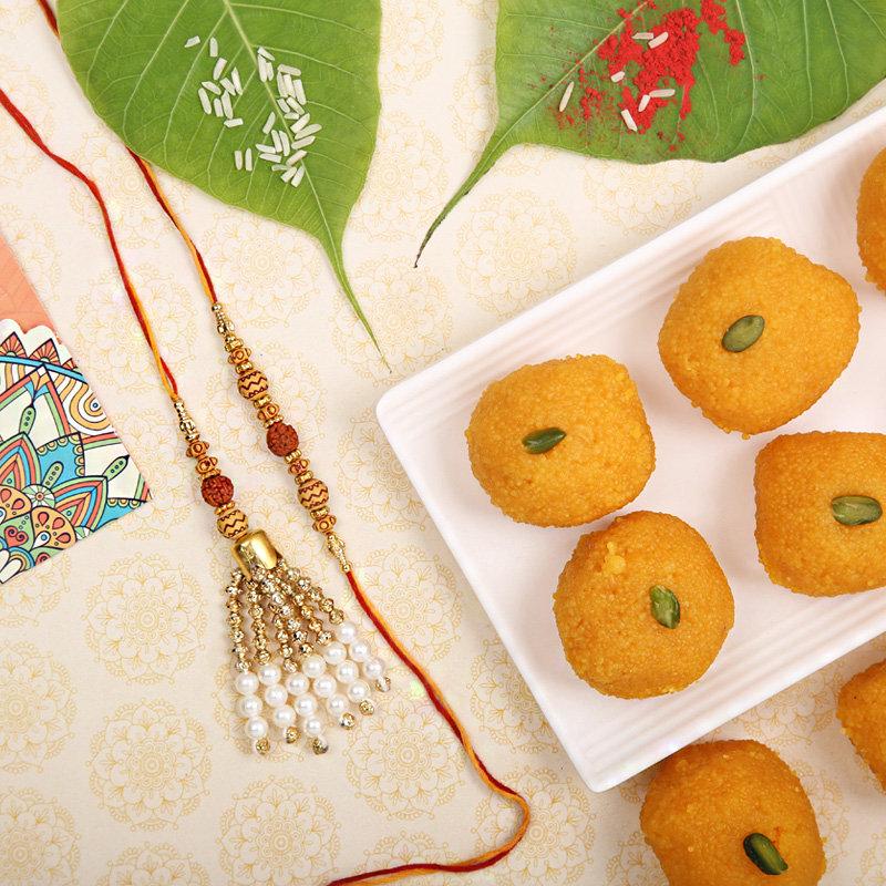 Sweet Rudraksha Lumba Rakhi Combo - Set of Bhaiya Bhabhi Designer Rakhi with Roli and Chawal and 500gm Motichoor Laddoo