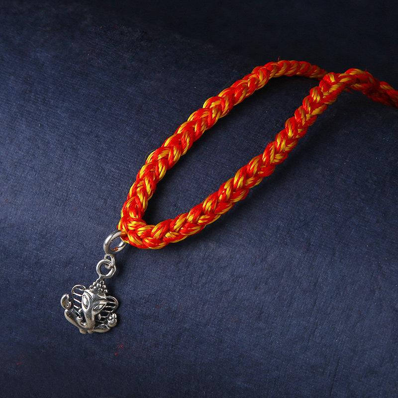 Sterling Silver Lambodar Rakhi - Silver Designer Rakhi Online