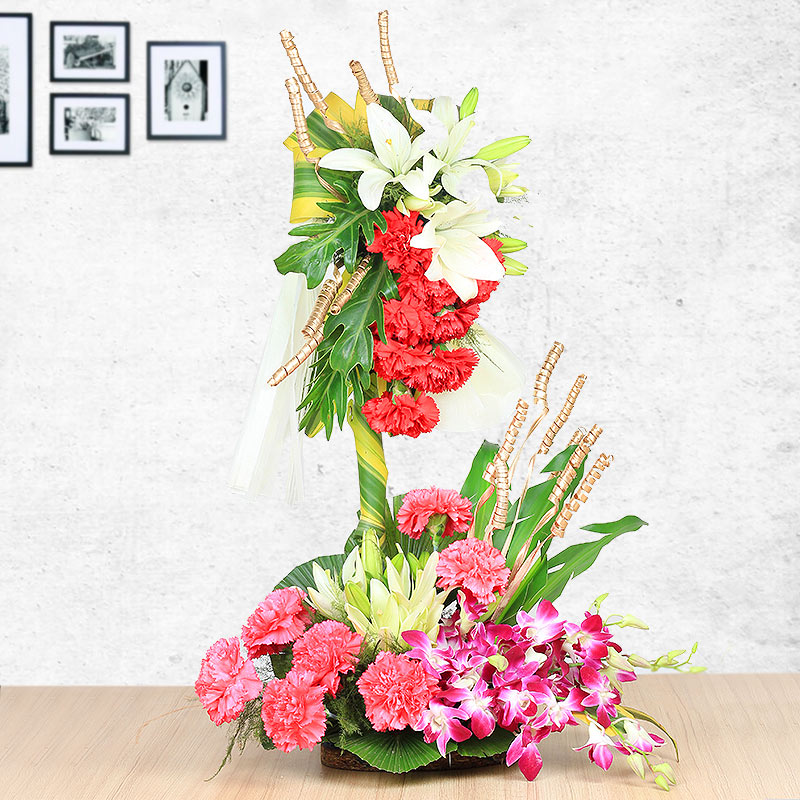 Mixed Color Carnations Lilies and Orchids in Basket