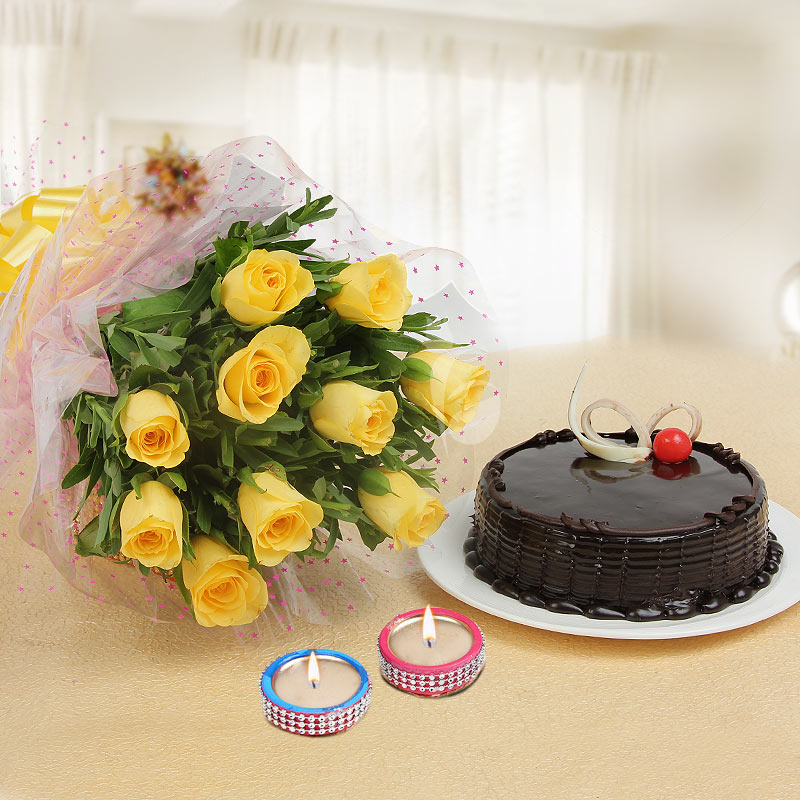 Warm Wishes - Diwali gift combo of 10 yellow roses with half kg chocolate truffle cake and 2 diyas