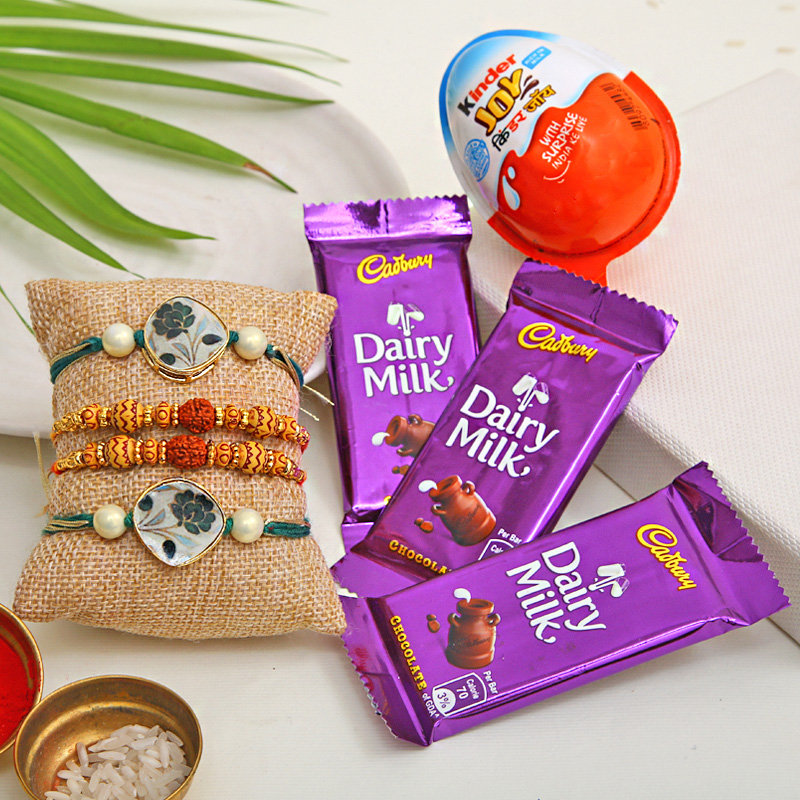 1 Kinder Joy with 3 Dairy Milk Chocolates and 4 Rakhi Combo - Order now for fast delivery