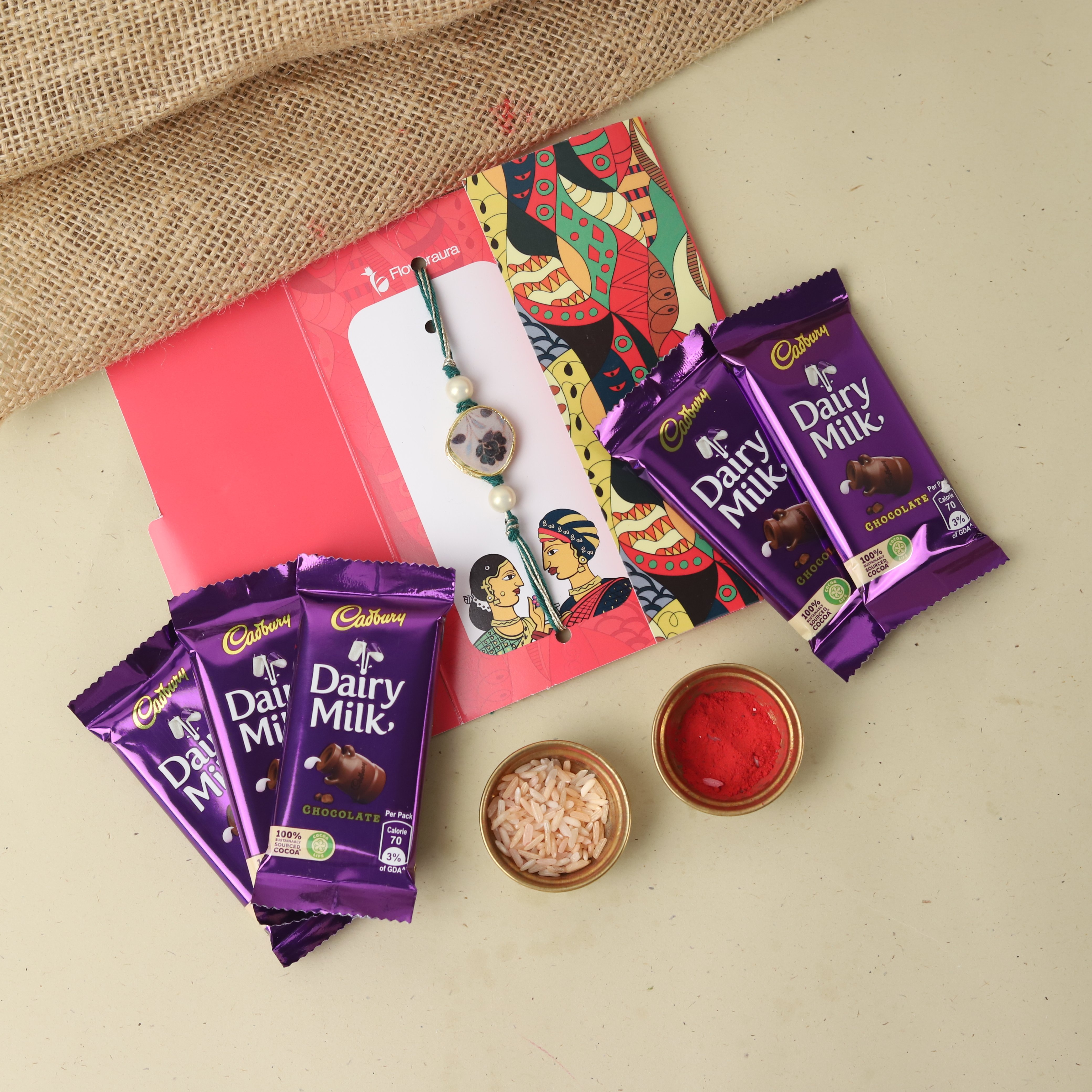 Rakhi with 5 Cadbury Dairy Milk Chocolate - Express Delivery Available