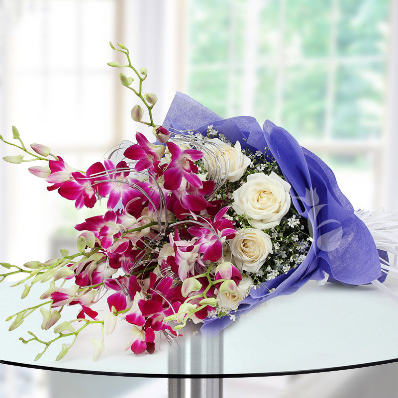 Bunch of 6 Orchid and 12 white roses on Table in Horizontal View