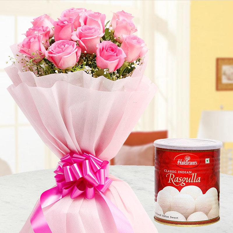 Pink roses bunch and Haldiram Rasgullas