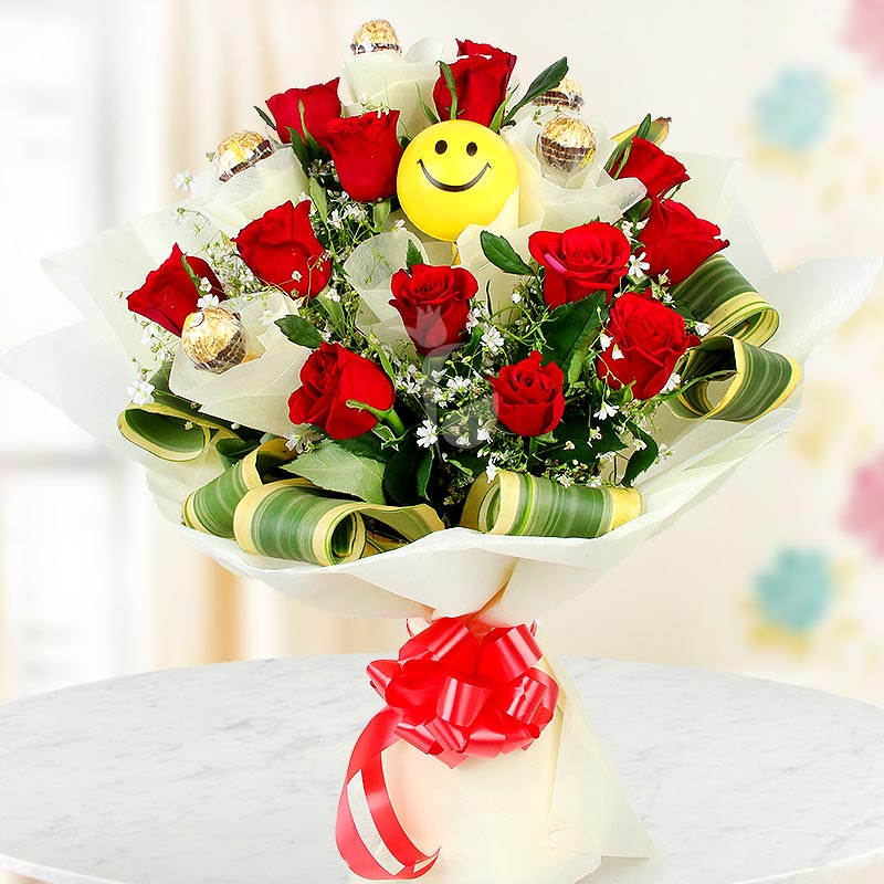 Smile All the Way - Combo of 12 red roses and 5 Ferrero Rocher chocolates with a smiley ball