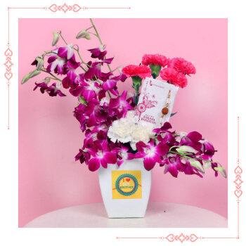 Buy Rakhi with flowers onine