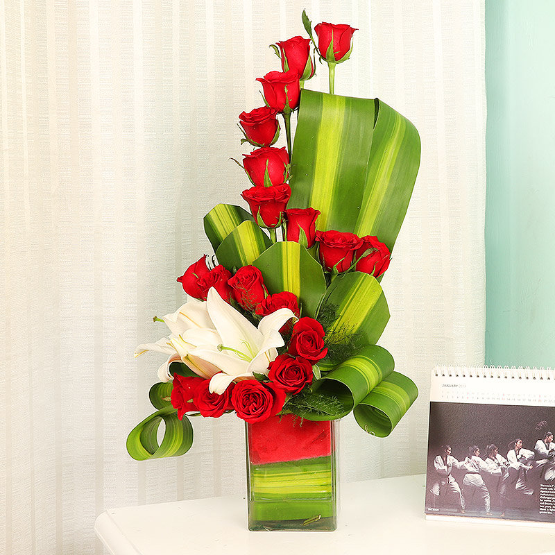 Arrangement of Red roses and White Lilies