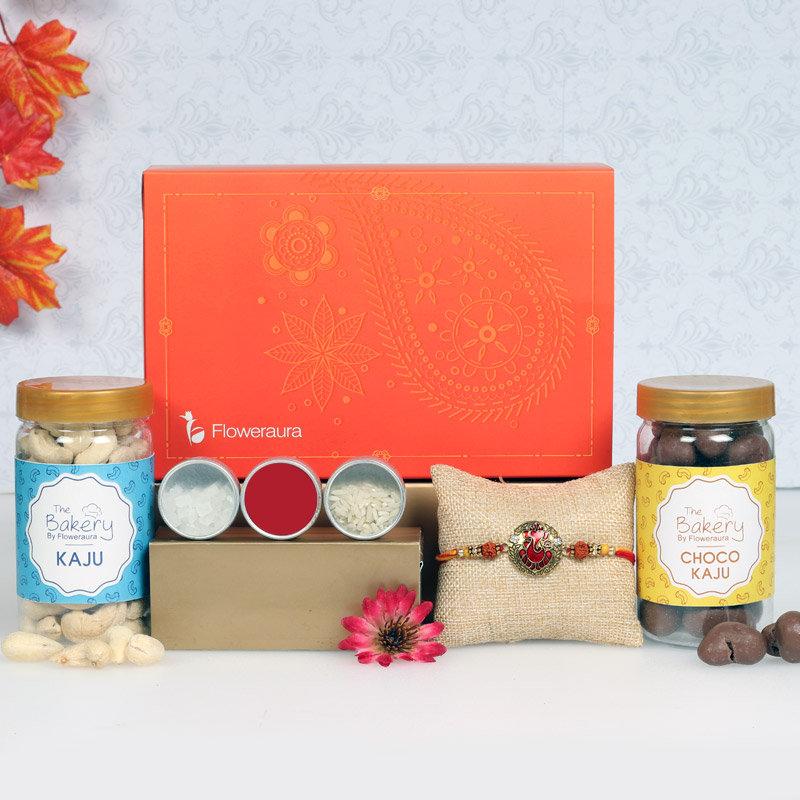 Amazing Rakhi Signature Box - One Ganesha Rakhi with Roli and Chawal and Choco Cashews and Cashews and One Floweraura Signature Box