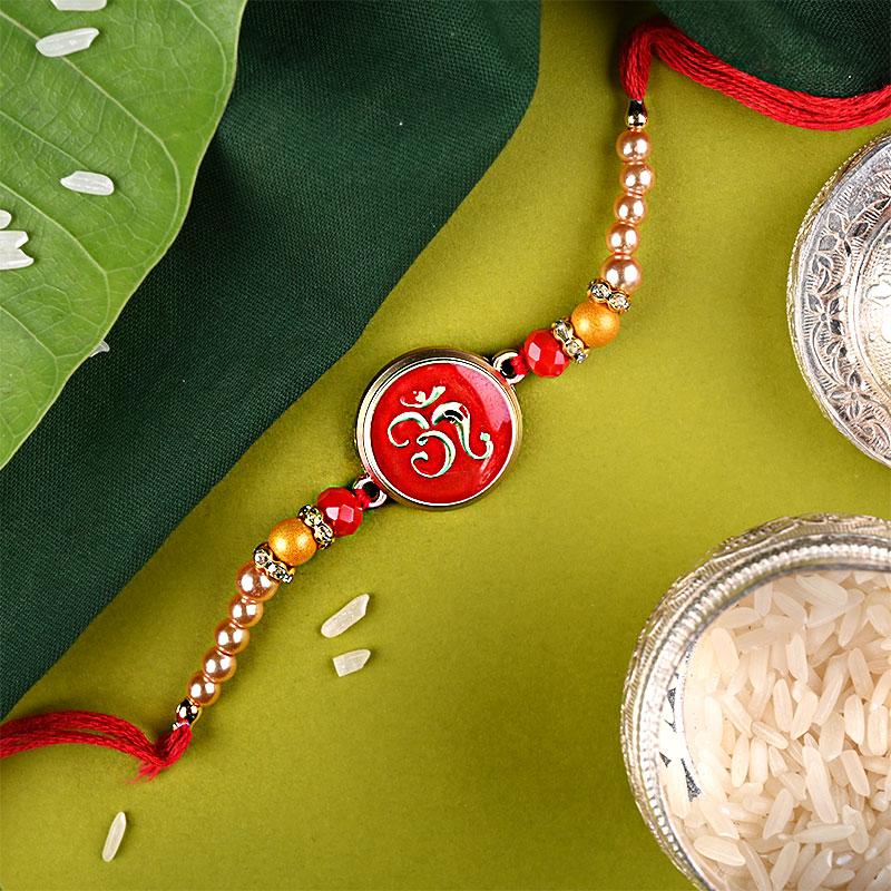 Auspicious Om Rakhi - One Designer Rakhi and Complimentary Roli and Chawal