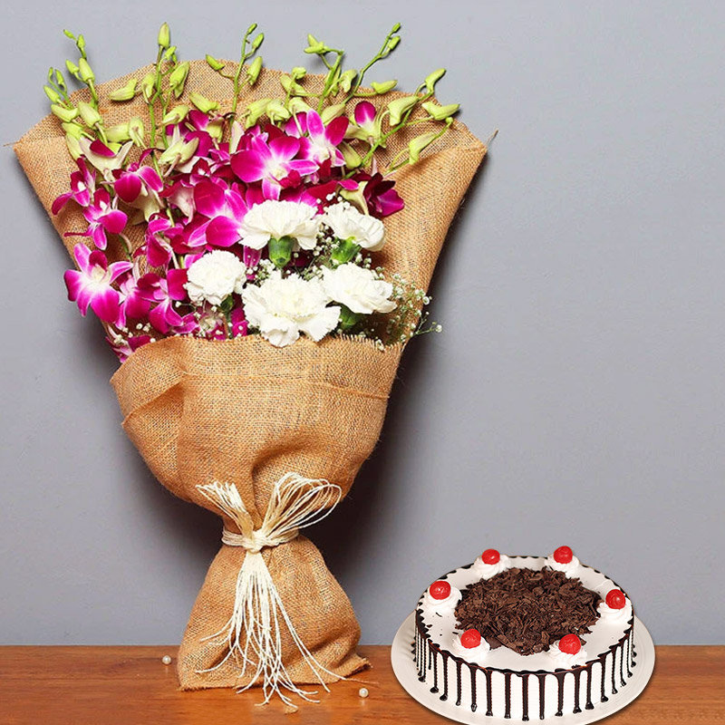Beautiful Sweetness - Jute Wrapped Bouquet of 6 Orchids and 5 White Roses with 1 Kg Black Forest Cake
