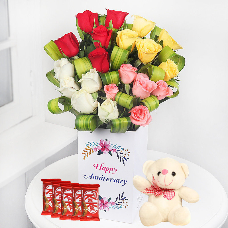 Blooms With Kitkat N Teddy Anniversary Combo - Bunch of 20 Red Roses with Anniversary Flower Box and 5 Nestle Kitkats