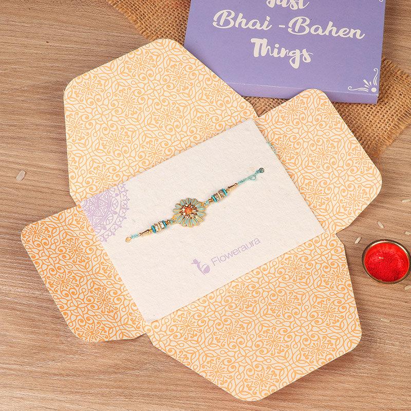 Rakhi in Blue Floral Designer Rakhi - Rakhi Gifts for Brother Online
