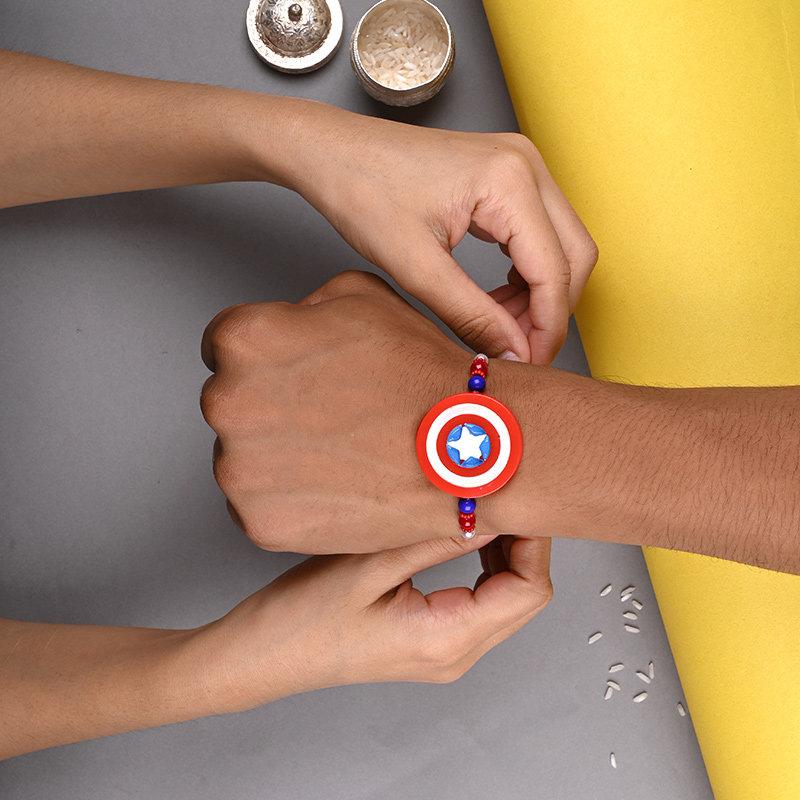Captain America Rakhi - One Cartoon Rakhi Tied on Kid Brother Hand
