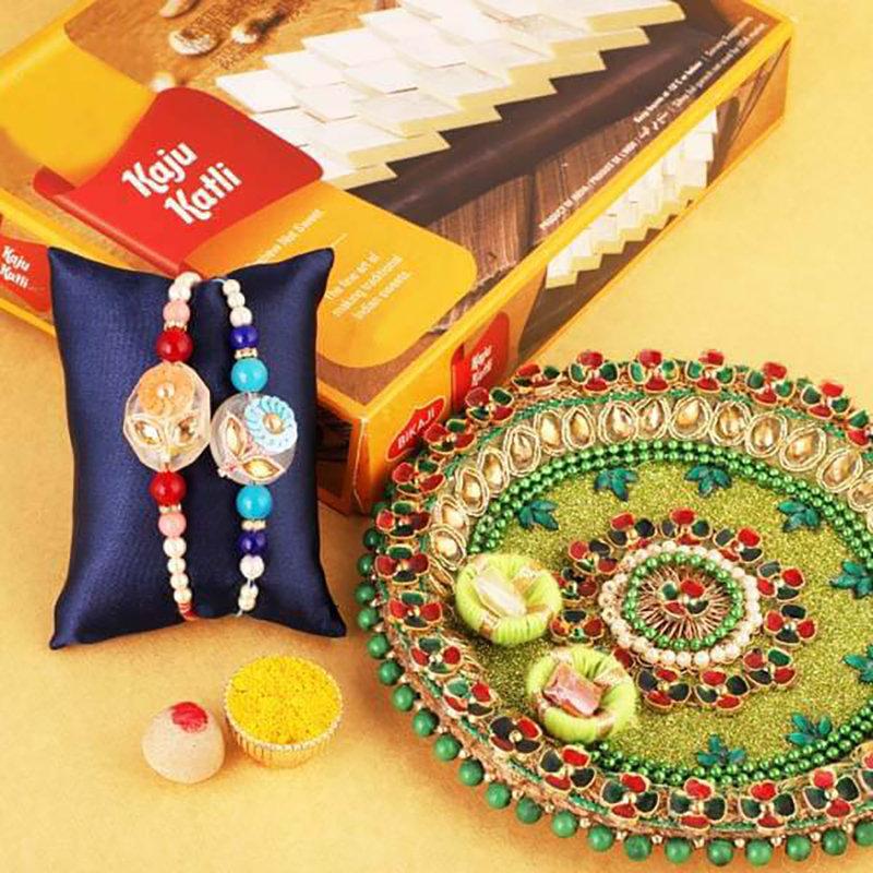 Charming Traditional Rakhi And Treats Combo