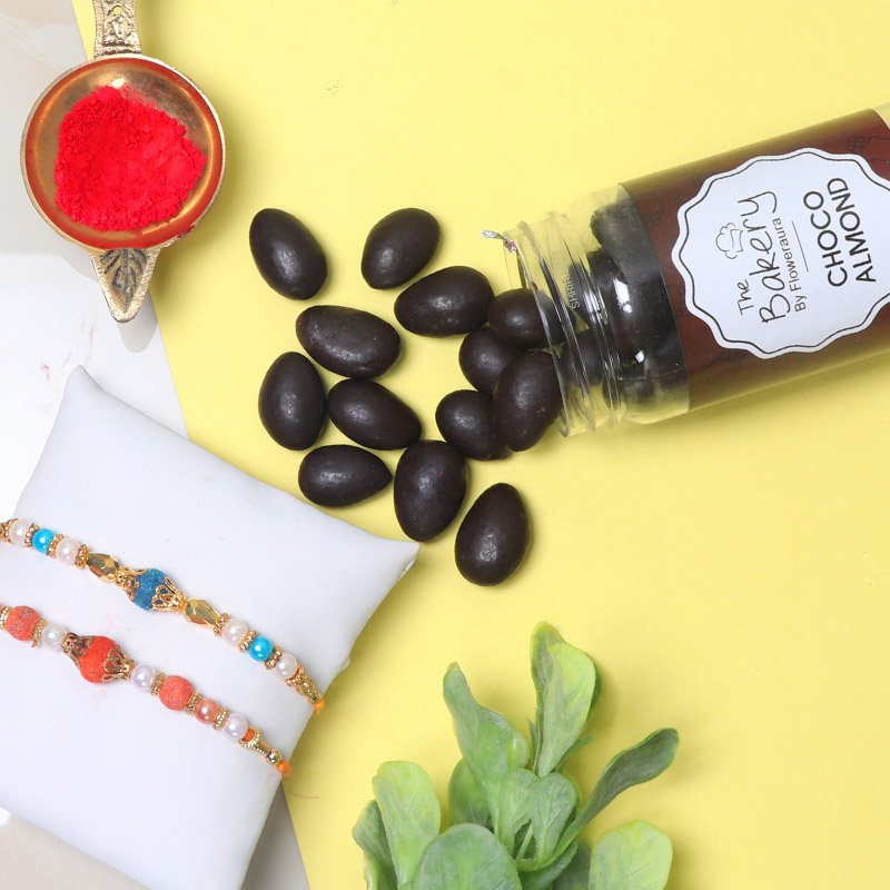 Choco Nut N Rakhi Combo - Set of 2 Designer Rakhis with Complimentary Roli and Chawal and 100gm Choco Almonds in Metallic Container