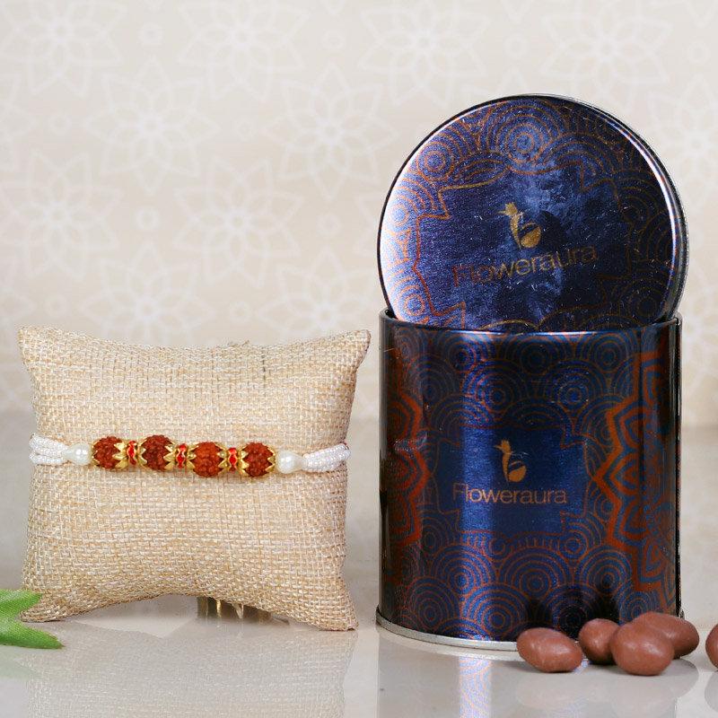 Choco Rudraksha Rakhi Combo - One Rudraksh Rakhi with Complimentary Roli and Chawal and 100gm Choco Raisins in Metallic Container