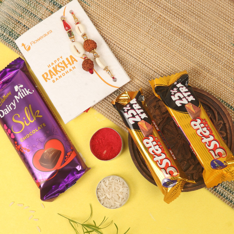 Chocolatey Bhaiya Bhabhi Rakhi Combo - Set of Bhaiya Bhabhi Rakhi with Roli and Chawal and One Dairy Milk Silk - 60gm and 2 Cadbury 5 Star Chocolates - 19.5gm each