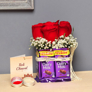 Chocolatey Rosy Posy - Arrangement of 6 Red Roses with 8 Dairy Milk Chocolates with Roli Chawal