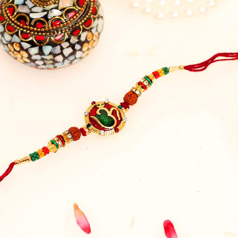 Colourful Om Rakhi - One Divine Rakhi and Complimentary Roli Chawal