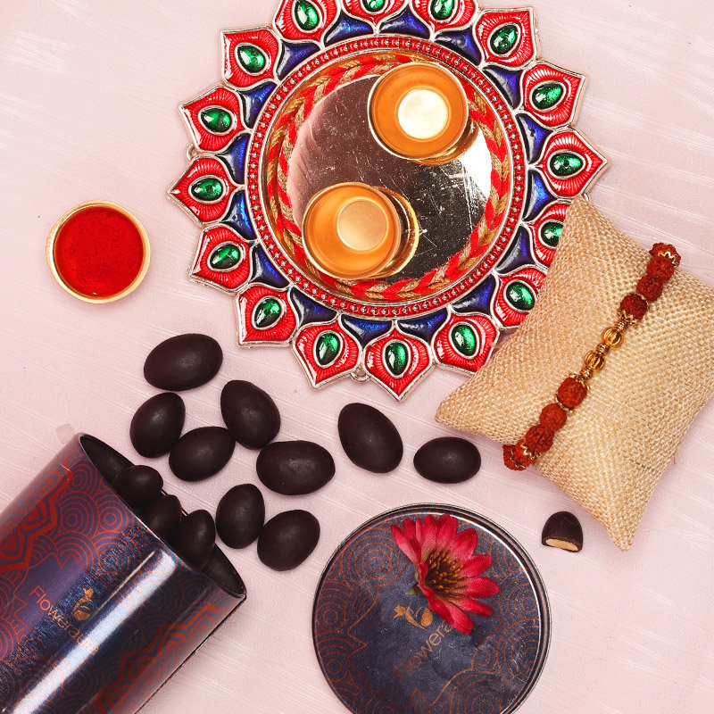 Delightful Rakhi Combo - One Rudraksh Rakhi with Complimentary Roli and Chawal and 100gm Choco Almonds in Metallic Container and One Designer Thali
