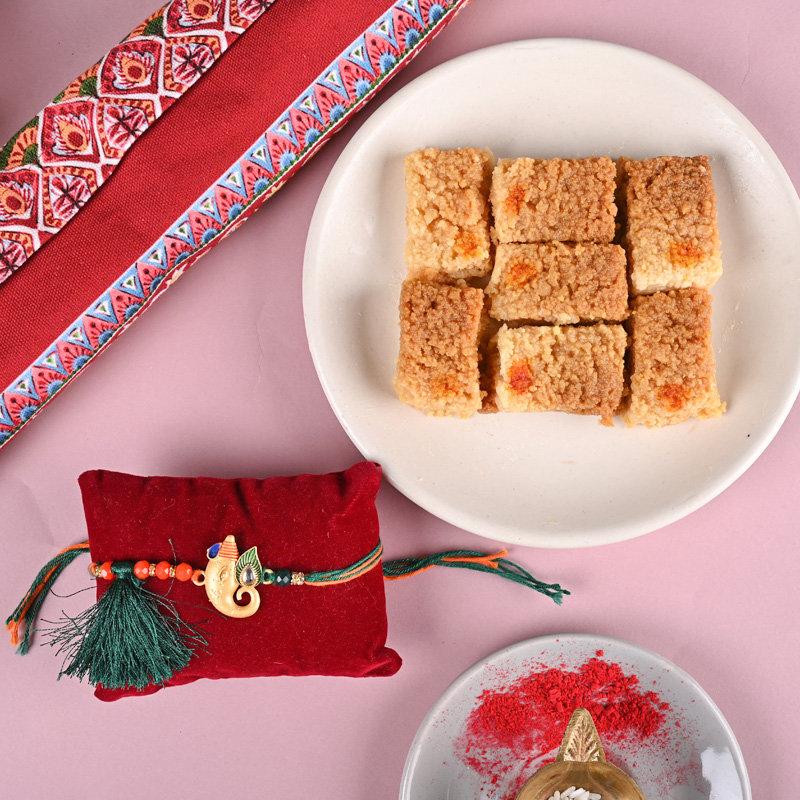 One Ganesha Rakhi - Designer Rakhi And Sweets Combo