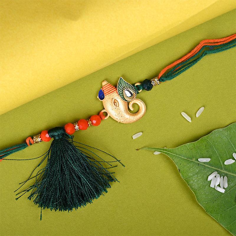 Order Designer Rakhi And Sweets Combo Online