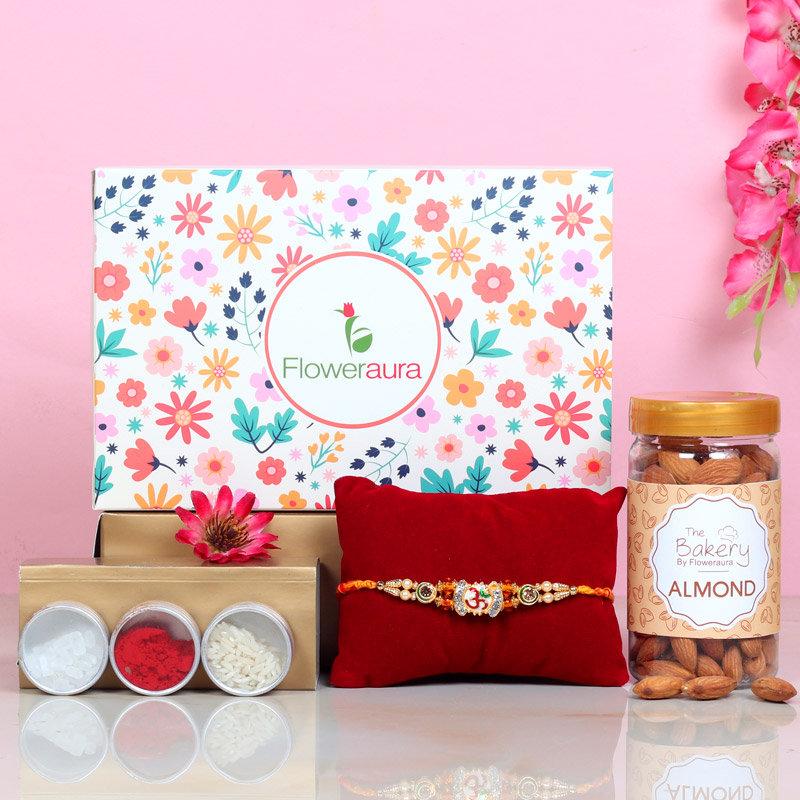 Designer Rakhi N Almonds - One Divine Rakhi with Roli and Chawal and Almonds and One Floweraura Signature Box