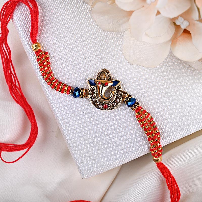 Elegant Blue Stone Ganesha Rakhi - One Ganesh Rakhi