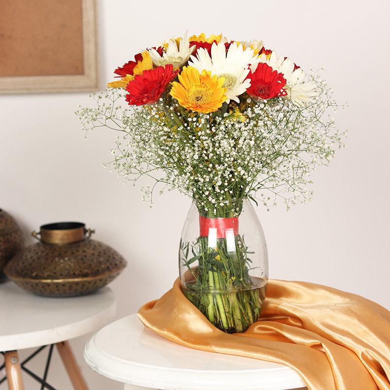 Flamboyant Sunflower Vase - 16 Mixed Gerberas in Glass Vase