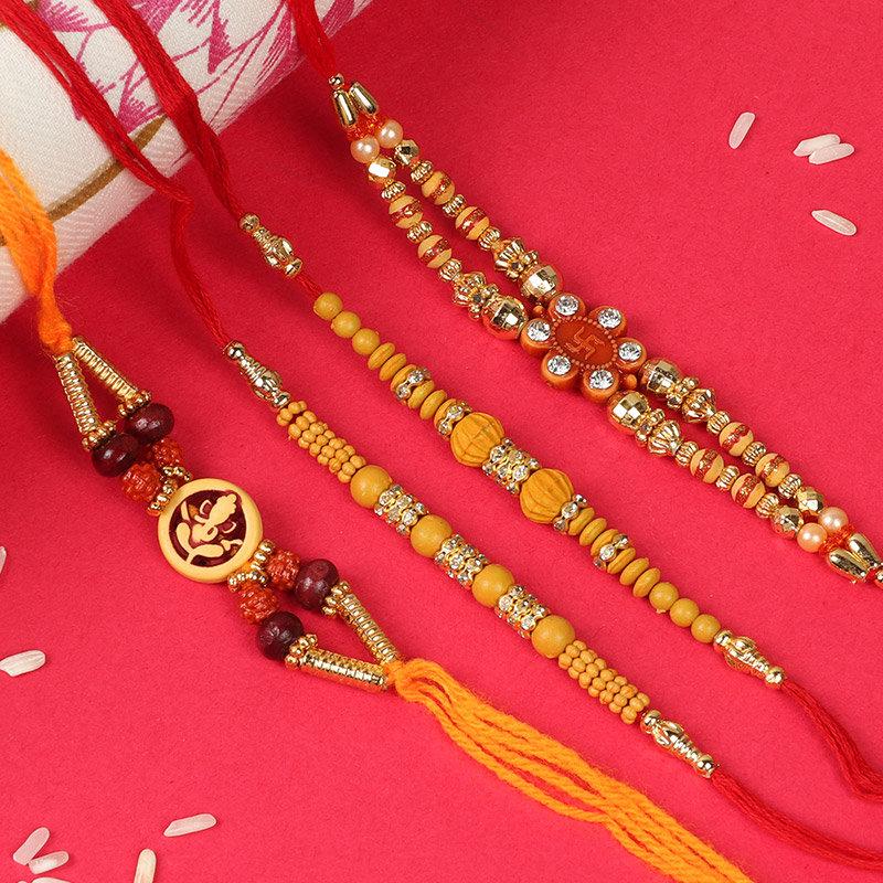 Four elegant Rakhi Set - Set of 4 Fancy Rakhis with Roli and Chawal
