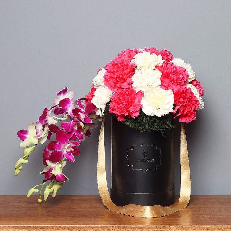 Bunch of Carnations and Orchids in a Flower Box