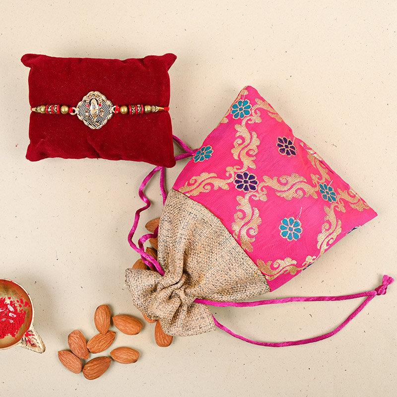 One Designer Rakhi - Ganesha Rakhi Almondy Combo