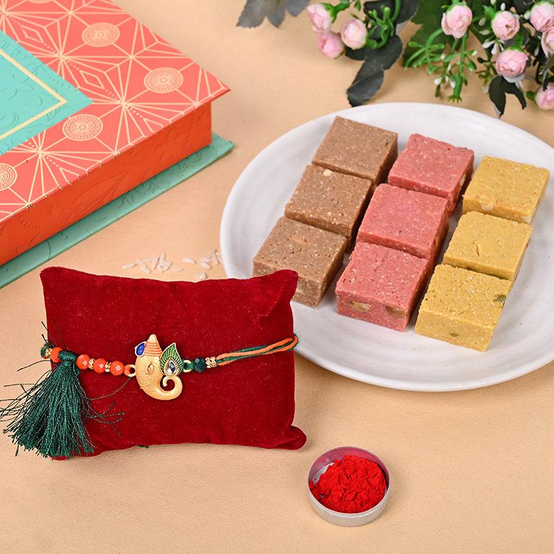 Holy Ganesha Rakhi With Sweets