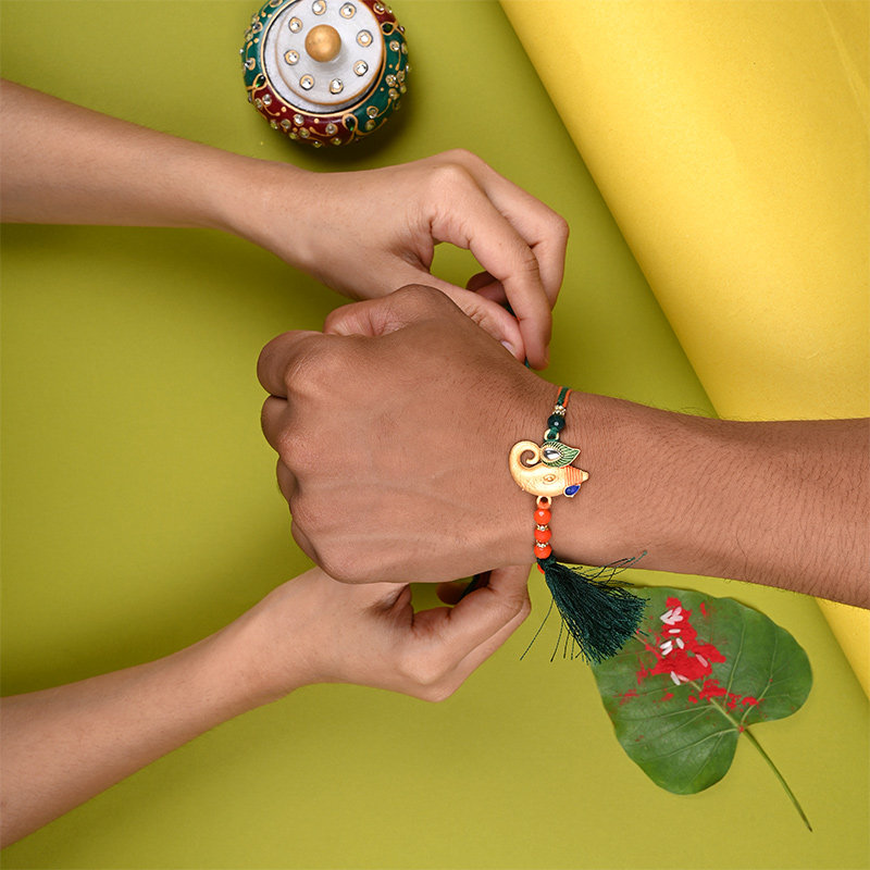 Order Ganesha Rakhi Online With Sweets For Your Brother