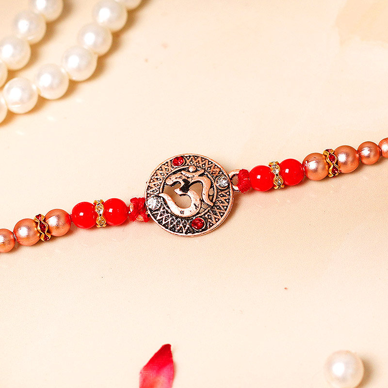 Incrated Om Rakhi - One Divine Rakhi with Complimentary Roli Chawal