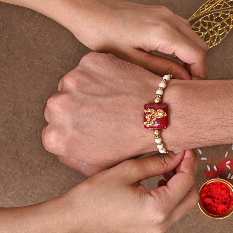 Kanha Rakhi Tied on Wrist