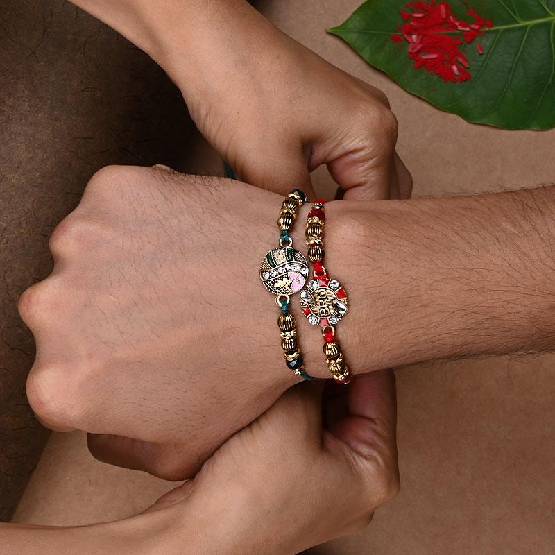 Kundan Rakhi online with chocolate gifts hamper rakhi on hand view