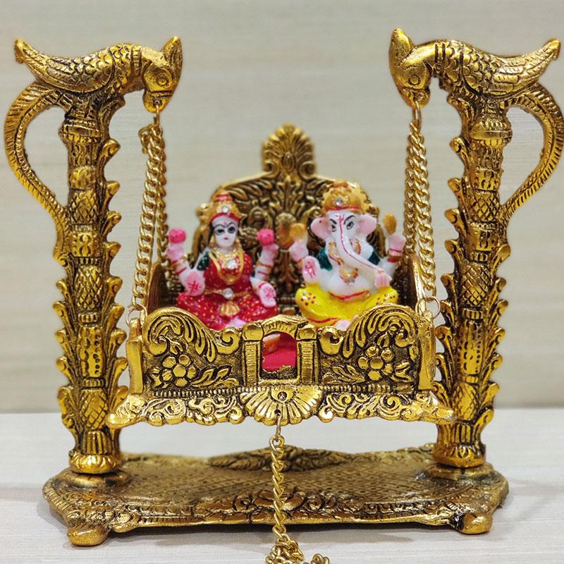 Laxmi And Ganesha Idols Bless Us