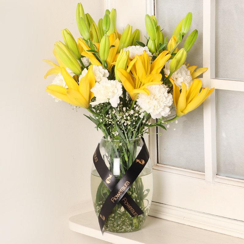Lily N Carnation Arrangement - Arragnement of 10 White Carnations and 6 Yellow Lilies </li><li> Glass Vase </li>