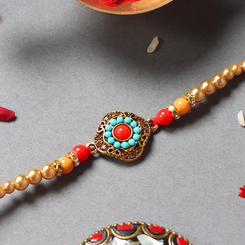 Metallic Red Blue Rakhi - One Metal Rakhi with Complimentary Roli Chawal