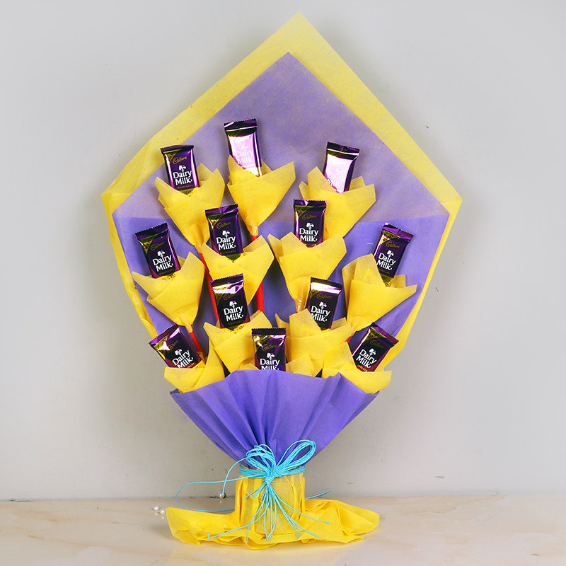 Milky Chocolicious Bouquet - Bouquet of 12 Dairy Milk Chocolates in Violet and Yellow Paper Packing