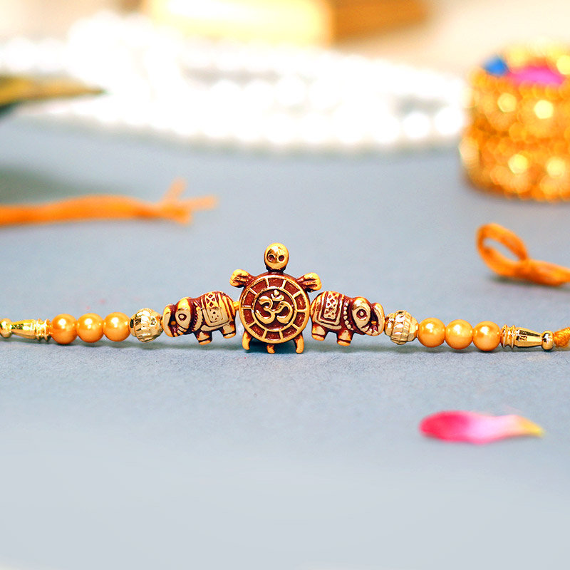 Om Turtle Beads Rakhi - A Fancy Rakhi - Order Online Now