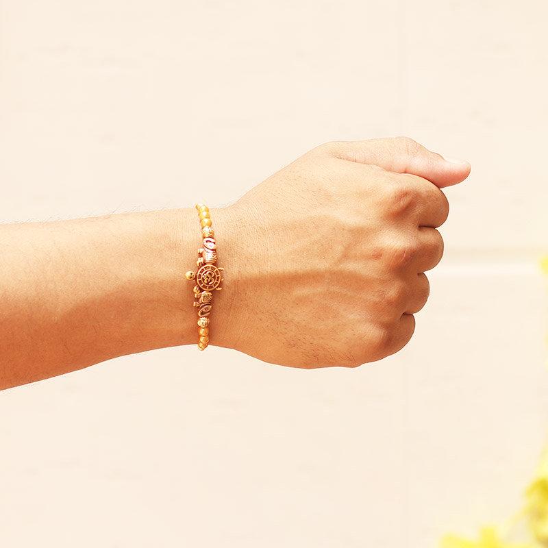 Om Turtle Beads Rakhi Tied on Wrist