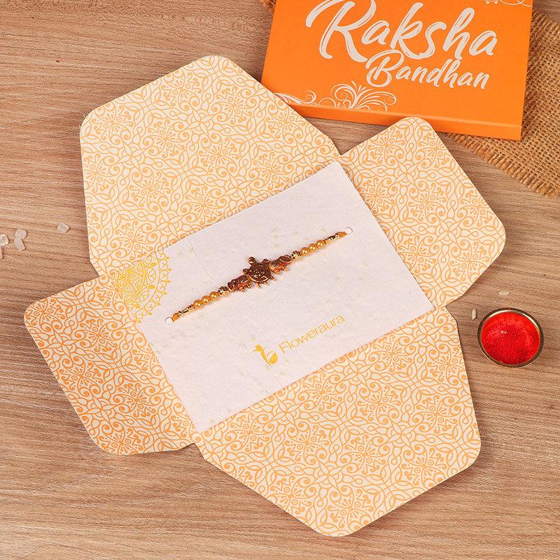 Om Turtle Beads Rakhi in Open Packaging