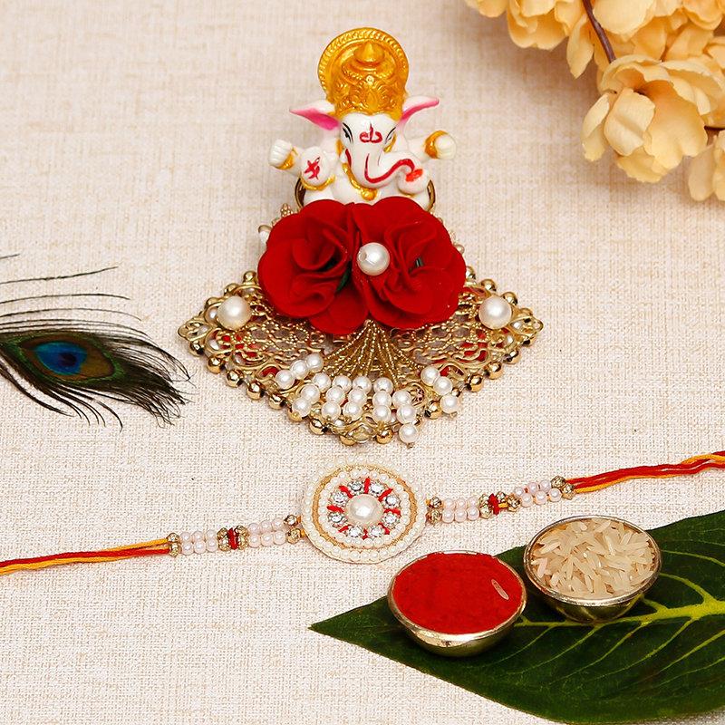 Pearl and Stone Designer Rakhi with Ganesha